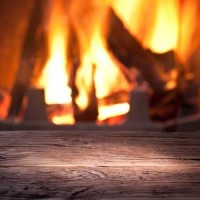 24310441-old-wooden-table-in-front-of-the-fireplace-